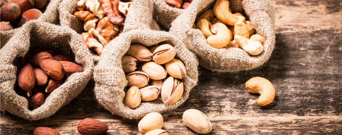 pistachios, almonds, and cashews in bags