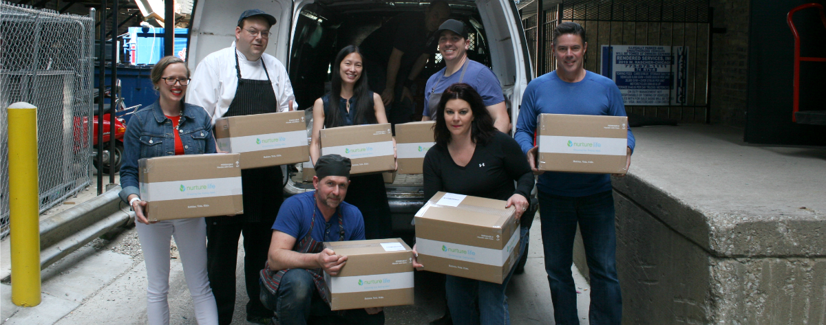 Picture of Nurture Life team with boxes