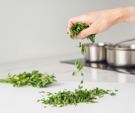 Hand dropping parsley
