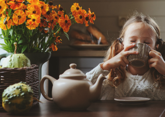 girl drinking tea at table